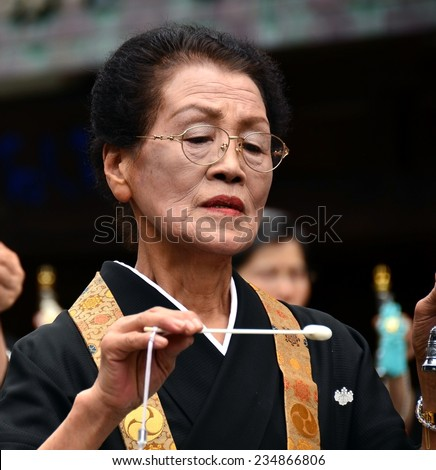 Koya, Japan - June 14, 2011: Woman in formal buddhist attire during Aoba festival, an annual event celebrating the birthday of Kobo Daishi (Kukai), one of Japan's most renowned Buddhist saints