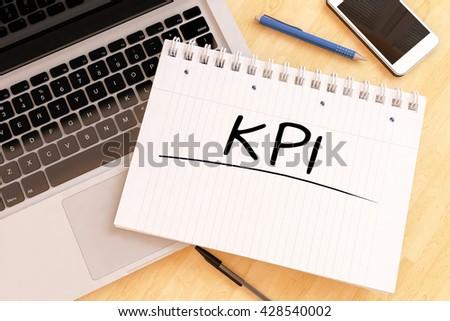 KPI - Key Performance Indicator - handwritten text in a notebook on a desk - 3d render illustration. - stock photo