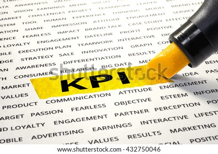 KPI word highlighted with marker on paper of other related words.For business concept
