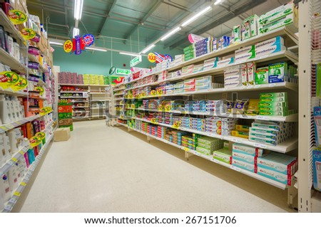 Krabi, 20 january 2015: Rows of shelves in Tesco Lotus supermarket in Krabi Muang district, Krabi province, Thailand.  Tesco Lotus is a largest hypermarket chain in Thailand. - stock photo