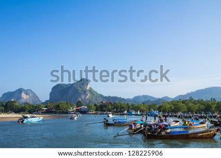KRABI, THAILAND - DECEMBER 1: Long tail boats in the sea at Aounang Bay on December 1, 2012  in Aounang Bay, Thailand. Many long tail boats are available for tourists service