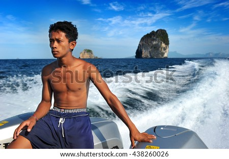 KRABI THAILAND - FEB 16 :Unidentified young man of Andaman speed boat worker on  Feb 16,2011 in Krabi Thailand