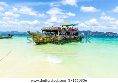 KRABI,THAILAND - FEBRUARY 11, 2013: Traditional Thai Longtail boat in the Andaman Sea, Thailand