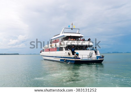 KRABI, THAILAND - 12 OCT 2014: Big luxury tourist charter boat ferry with tourists onboard off the mainland from Krabi to Phuket, Thailand.