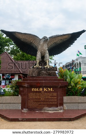 KRABI, THAILAND - 14 OCT 2014: Large statue of a white-breasted sea eagle, with informational plaque, prominently displayed at the beginning of a highway in Krabi Town, Thailand. - stock photo