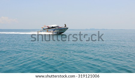 Krabi, Thailand - Sep 12, 2015. Tourist boat on the beautiful beach in sunny day in Krabi. Tourism is an important industry in Southern Thailand.
