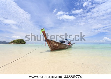 Krabi, Thailand, September 15, 2013 : A long tail boat bring tourist to travel beautiful island in Thailand