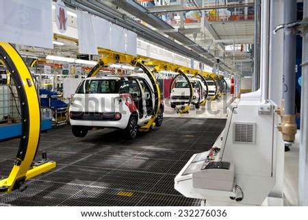 KRAGUJEVAC, SERBIA - CIRCA APRIL 2012: Car production line at Fiat Cars Serbia factory, circa April 2012 in Kragujevac. - stock photo