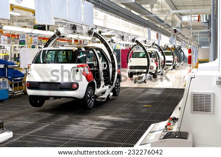 KRAGUJEVAC, SERBIA - CIRCA APRIL 2012: Car production line at Fiat Cars Serbia factory, circa April 2012 in Kragujevac. - stock photo