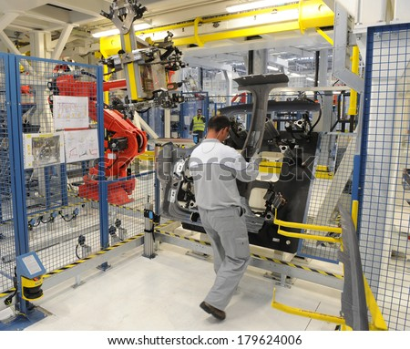 KRAGUJEVAC, SERBIA - CIRCA APRIL 2012: Workers assembles cars at Fiat Cars Serbia factory, circa April 2012 in Kragujevac.