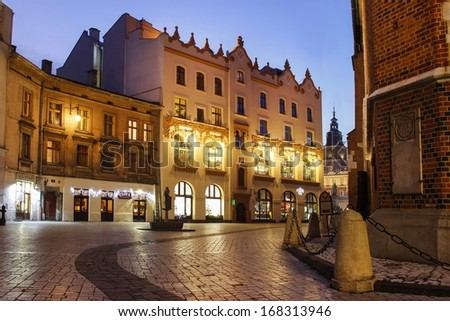 KRAKOW - DECEMBER 21: City center by night: ancient temements . Plac Mariacki square, Krakow, Poland on December 21, 2013.