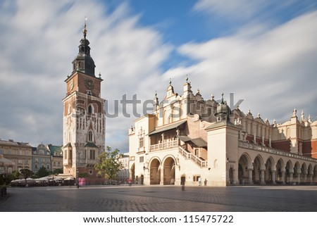 Krakow main square with the Tower and the Sukiennice cloth hall - stock photo