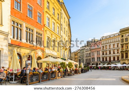 KRAKOW, POLAND - APR 29, 2015: Architecture of the Market square in the Old town of Krakow, Poland. Old Town of Krakow is one of most famous old areas in Poland