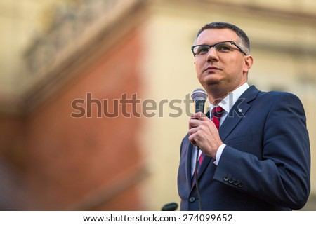 KRAKOW, POLAND - APR 29, 2015: Przemyslaw Wipler - Polish politician, member of Parliament of the VII convocation, during pre-election rally of Janusz Korwin - of presidential candidate of Poland. - stock photo