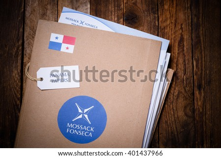 KRAKOW, POLAND - APRIL 5, 2016 : Folder with Mossack Fonseca logo and printed documents from company web site. Panama Papers are millions leaked documents with information about offshore companies. - stock photo