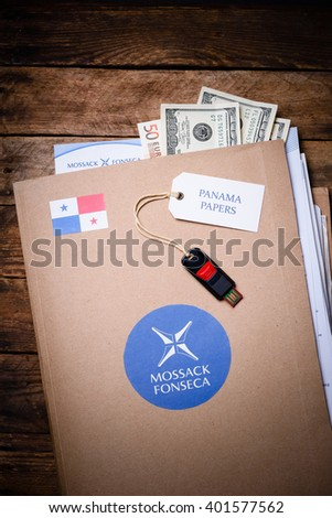 KRAKOW, POLAND - APRIL 5, 2016 : Folder with Mossack Fonseca logo with US and EU currency.  Panama Papers are millions leaked documents with information about offshore companies. - stock photo