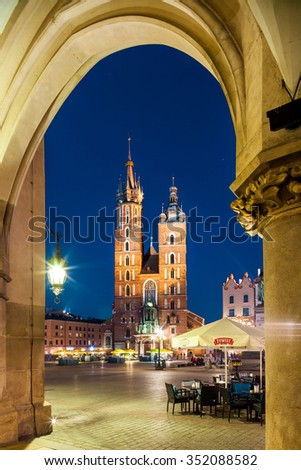 Krakow - Poland - April 22. Krakow - the most known monument in Krakow -St. Mary's Church. Night picture with Cloth Hall on foreground. Highlighted Church and Cloth Hall. Krakow - Poland - April 2015. - stock photo