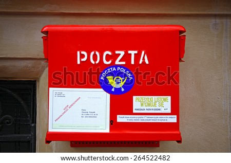 KRAKOW, POLAND - DECEMBER 27, 2011: Polish National Post red mailbox on the street of Krakow. Polish postal service was established in 1558 by starting permanent postal route between Krakow and Venice - stock photo