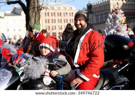 KRAKOW, POLAND - DECEMBER 6 : Santas participate in the International Santa Claus motorcycle parade on Dec.6, 2015 in Krakow , Poland. They stop in the City center and give charity gifts for children