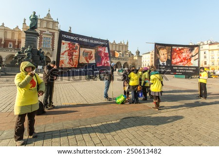 KRAKOW, POLAND - FEB 7, 2015: Unidentified participants protests against abortion on Main Market Square near Church of Our Lady Assumed into Heaven (also known as St. Mary's Church) - stock photo