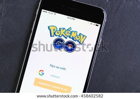 Krakow, Poland - July 25, 2016 : Mobile phone with popular game Pokemon Go running on screen.  - stock photo