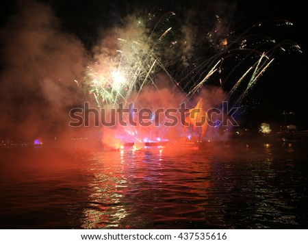 KRAKOW, POLAND - JUNE 4, 2016:  Yearly Great Dragons Parade connected with the fireworks display, taking place on the river Vistula at Wawel. Cracow , Poland