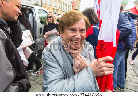 KRAKOW, POLAND - MAY 2, 2015: During Flag Day of the Republic of Polish - is national festival introduced by the Act of 20 Feb 2004. On the same day is celebrated Day of Polonia and Poles Abroad.