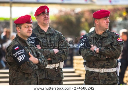 KRAKOW, POLAND - MAY 3, 2015: Military gendarmerie during annual of Polish national and public holiday the May 3rd Constitution Day. Holiday celebrates declaration of the Constitution of May 3, 1791.