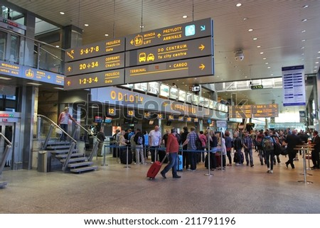 KRAKOW, POLAND - MAY 12, 2014: People wait at Krakow International Airport in Poland. The airport had 3.6 million passengers in 2013 (2nd place in Poland). - stock photo