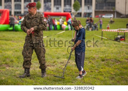 KRAKOW, POLAND - MAY 3, 2015: Unidentified child during demonstration of the military and rescue equipment during annual Polish national and public holiday the Constitution Day May 3rd.