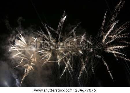 KRAKOW, POLAND - MAY 30, 2014: Yearly Great Dragons Parade connected with the fireworks display, taking place on the river Vistula at Wawel. Cracow , Poland - stock photo