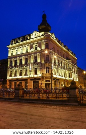 KRAKOW, POLAND - NOVEMBER 24, 2015: Ancient tenements by night in Krakow, Poland.