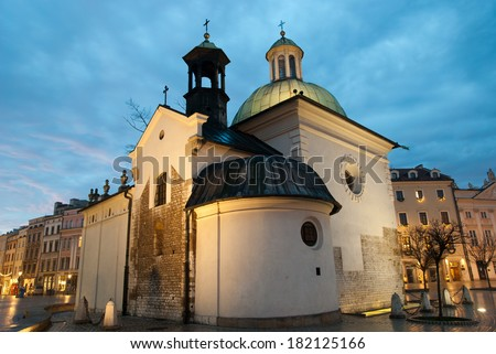 KRAKOW, POLAND The Church of St. Wojciech in the Market Square, built in the Romanesque style, rebuilt in the Baroque style in the 17th and 18th century.  - stock photo