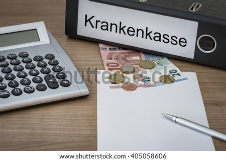 Krankenkasse (German Health Insurance) written on a binder on a desk with euro money calculator blank sheet and pen