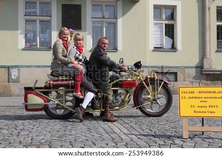 KRASNA LIPA, CZECH - AUGUST 31 2013: 15th year of the international meeting of unique vintage Cechie-Bohmerland motorcycles in Krasna Lipa. Photo from great motorcycle parade. Public-event. - stock photo