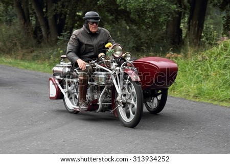 KRASNA LIPA, CZECH - AUGUST 29 2015: 17th year of the international meeting of unique vintage Cechie-Bohmerland motorcycles in Krasna Lipa. Photo from great motorcycle parade. Public-event.  - stock photo