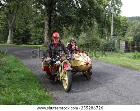 KRASNA LIPA, CZECH - SEPTEMBER 01 2012: 14th year of the international meeting of unique vintage Cechie-Bohmerland motorcycles in Krasna Lipa. Photo from great motorcycle parade. Public-event.  - stock photo