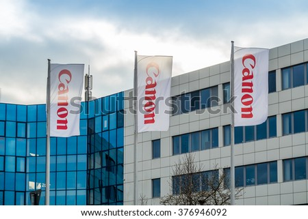 KREFELD / GERMANY - FEBRUARY 15 2016 : Canon office building with company flags in the foreground