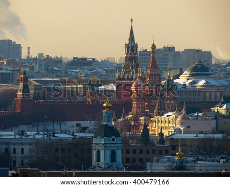 Kremlin wall, Spassky Tower and St Basil Cathedral in Moscow, Russia - stock photo