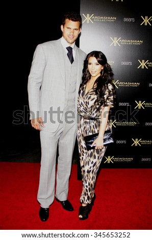 Kris Humphries and Kim Kardashian at the Kardashian Kollection Launch Party held at the Colony in Los Angeles, California, United States on August 17, 2011.   - stock photo