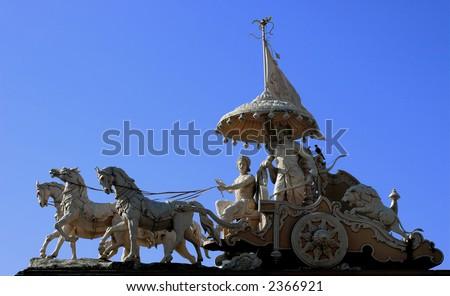 Krishna and Arjuna in the chariot. Hindu monument in Rishikesh, India. - stock photo