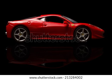 KRIVOY ROG, UKRAINE - AUG 22- Toy ferrari 458 Italia on black background, Friday 22 August 2014 - stock photo