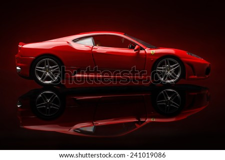 KRIVOY ROG, UKRAINE - DEC 25- Toy ferrari F430 on red background, Thursday 25 December 2014 - stock photo
