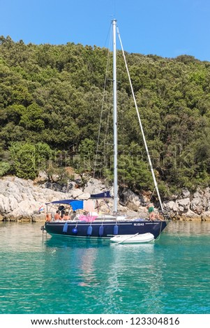 KRK, CROATIA - AUGUST 14, 2011: Sailboat anchored in the bay on August 14, 2011 in Krk, Croatia. Many tourists visit the Croatian islands exclusively with sailboats.