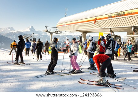KRONPLATZ, ITALY - FEBRUARY 3: Skiers get ready to cruise down the mountain on February 3, 2012, at the Kronplatz Ski Resort, Italy. Kronplatz is the premier ski resort in South Tyrol. - stock photo