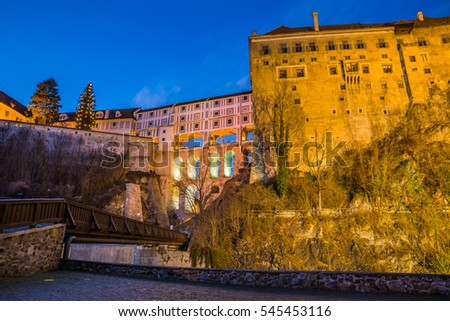 KRUMLOV, CZECH REPUBLIC - DECEMBER, 2016: View of fortification walls of castle in Cesky Krumlov at night.