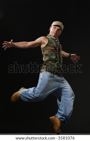 krump style dancer jumping on leg - stock photo