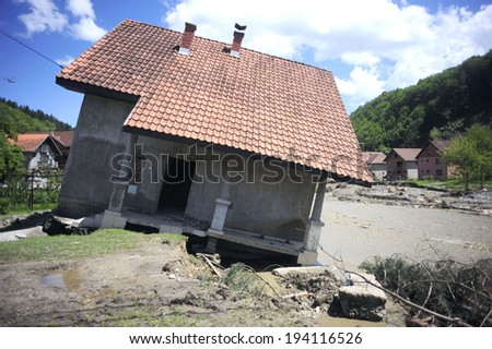 Krupanj-May 19,2014: After recent heavy rains, river Cadjavica went out of stream, causing catastrophic floods and mud slides, wich destroyed town of Krupanj in Macva district in central Serbia.  - stock photo