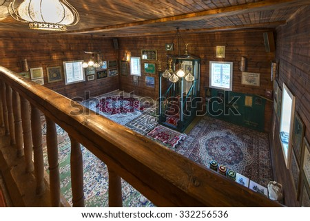 KRUSZYNIANY, POLAND - SEPTEMBER 30, 2015: Wooden tatar-mosque interior from the 18th century. Mens prayer room is separated from womens prayer room. The minbar of mosques is of an austere design. - stock photo