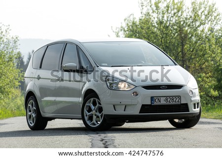 Krynica-Zdroj, POLAND - MAY 21, 2016: White Ford Focus S-MAX on the asphalt road.  - stock photo